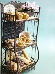I LOVE THIS!  It's a miniature bakery shelf that is only 6 1/2 inches high.  How awesome is that?
