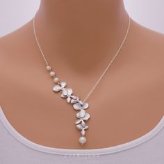 Pearls and Orchid Necklace, Sterling Silver Chain / N134S by CreBijoux on Etsy https://www.etsy.com/listing/155740638/pearls-and-orchid-necklace-sterling
