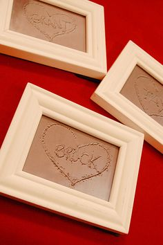 Names in sand, then frame them. So cute!