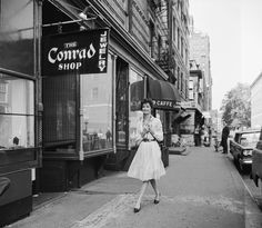 A tourist on a walking tour of New York visits the shops and cafes of Greenwich Village. 1956. (Getty Images)