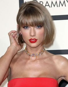 Taylor Swift sported a cute bob with bangs and bright red lipstick at the 2016 Grammy Awards. And how awesome is her rainbow Lorraine Schwartz choker and delicate red stud earrings