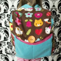 This back pack turns into a sleeping bag!  Great for grandma's house or sleep overs. Free pattern and tutorial.