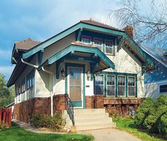 The clipped gables suggest English roots for this 1-1/2-story semi-bungalow.
