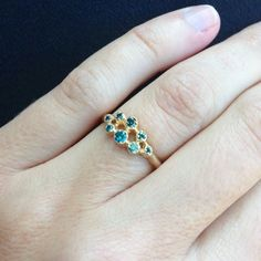 A one of a kind Shaesby ring with blue gemstones.