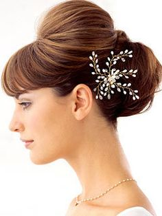 it's a cute wedding updo with a pretty clip.