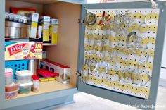 We're a huge fan of harnessing a cabinet back's hidden storage. Here, a pegboard helps a pile of cookie cutters eat up way less space. See more at 2 Little Superheroes »   - CountryLiving.com