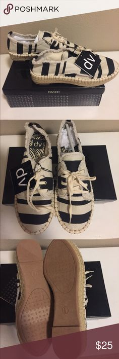 DV canvas sneakers Ivory and black striped canvas sneakers. BRAND NEW with box. Tie front DV by Dolce Vita Shoes Sneakers