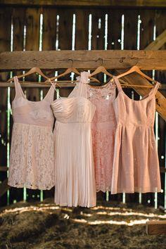 Mismatched pink bridesmaid dresses.
