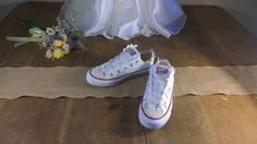 These beautiful wedding converse are hand decorated with lace and pearl beads to add sophisticated and elegant detail to your feet. Who says
