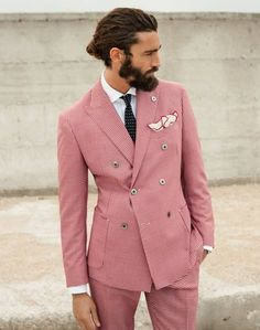 Love the pink and the pink lined pocket square, not so sure about the skinny bow tie
