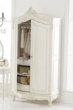 Wardrobe ~ I would remove the doors and put a curtain in it, pattern to coordinate/ not match exactly with chair back~LG