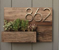 This house number planter box makes the perfect addition to any front porch. We start by staining poplar wood a Dark Walnut color and seal it well with a water based, satin finish polyurethane. Three holes are drilled into the bottom of the planter box se Wooden Table Diy, Table En Bois Diy, Diy Table, Wood Table, Diy Wood, Wood Crafts, Paper Crafts, Diy Casa, Succulents