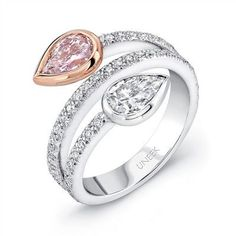 Uneek Pink and White Pear Diamond Bypass Ring: This white gold ring is designed with bypass style and set with a fancy pink pear-shape diamond in a rose gold bezel, and a pear-shape white diamond intersects it. 49 round-cut diamonds of decorate the ring. Pink Diamond Engagement Ring, Pink Diamond Ring, Diamond Gemstone, Solitaire Engagement, Pink Sapphire, Pear Shaped Diamond Ring, Pear Diamond, Popular Engagement Rings, Designer Engagement Rings