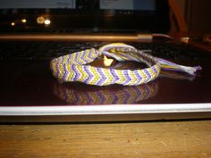 Christmas bracelet with a present charm purple, yellow, white and blue by redhoodgirl on Etsy