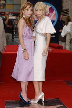 Mary-Kate and Ashley choose summery dresses while receiving their star on the Hollywood Walk of Fame.    - ELLE.com