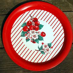 Visit my blog http://cdiannezweig.blogspot.com/ and my site http://iantiqueonline.ning.com/  Cherries & stripes vintage metal tray