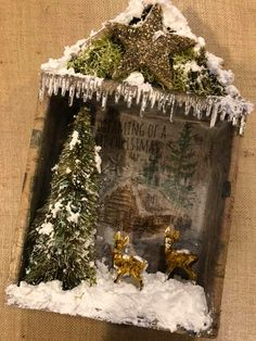 Beautiful shadow box with lots of Tim Holtz elements such as the little deer and the log cabin stamp in the background. Christmas Booth, Christmas Shadow Boxes, Prim Christmas, Christmas Scenes, Christmas Paper, All Things Christmas, Christmas Holidays, Vintage Christmas Crafts, Quilted Christmas Ornaments