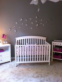 purple, white, and silver baby nursery