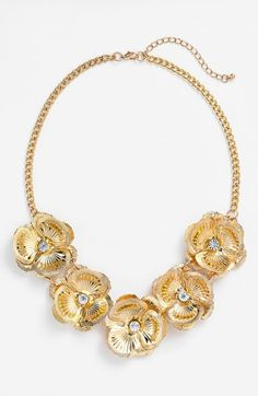 Such a pretty sparkly floral statement necklace. Will pair with a cute skater dress.