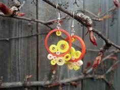 He encontrado este interesante anuncio de Etsy en https://www.etsy.com/es/listing/231708073/round-orange-paper-quilling-earrings