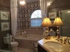 Master Bathroom by Annette, New York with Walls Republic Plush Damask Wallpaper in Byzantium: http://www.wallsrepublic.com/purple-damask-wallpaper-p/r1042-parent.htm