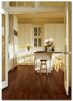 Dark hardwood floors.  Looks just like my kitchen floor; love the dark wood with light cabinet color (mine are white).