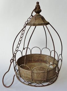 Hey, I found this really awesome Etsy listing at http://www.etsy.com/listing/169169762/vintage-rusty-metal-hanging-planter-with
