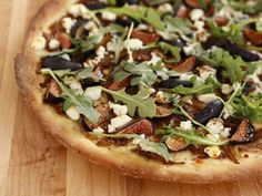 Spencer makes a fantastic fig, goat cheese, carmelized onion and fennel pizza. It would be fun to have various gourmet pizzas as part of the appetizers