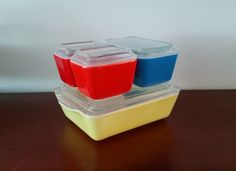 Pyrex refrigerator set in primary yellow, blue and red by TheHouseofHelga on Etsy