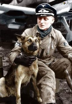 Unknown Leutnant with his Schäferhund. In the background is a Messerschmitt Bf 109E-4 (7 ?) It could be during the Battle of Britain and the...