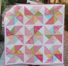 Pink Pinwheel Baby Girl Quilt with Aqua, green, yellow accents. $100.00, via Etsy.