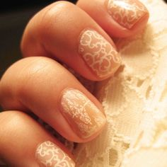 Check out this feminine and playful nail art for the spring. This subtle yet intricate design would be great for wedding nails too!