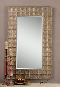 """Mirror is made from hand hammered metal mirror, this frame is finished in antiqued gold with a brown glaze. Mirror has a generous 1 1/4"""" bevel. May be hung horizontal or vertical. http://www.decorbound.com/store/#!/Gavino/p/41576216/category=10288417"""