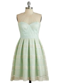 I absolutely LOVE this look! A feminine mint green and the sheer ivory neck piece adds a touch of class. #modcloth