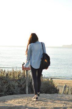 light wash denim shirt, black jeans, black vans, backpack