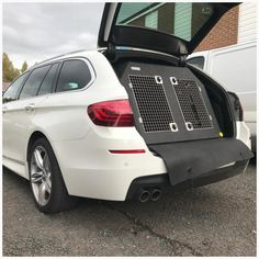 BMW 5 Series Touring (2017 - Present) Dog Car Travel Crate - The DT 2 About the DT 2 The DT 2 is a great box for larger estate cars with lots of space for two large dogs. This box features a removable divider which when removed really opens it up into a massive box. The box is made from a super tough lightweight plastic and to make this easy to clean we have included drainage plugs. Design The box is made from a super tough lightweight plastic which makes it easy to lift in and remove from… Dog Travel Crate, Car Travel, Pet Vet, Dog Crates, Stainless Steel Doors, Medium Sized Dogs, Bmw 5 Series, Dog Car, Large Dogs
