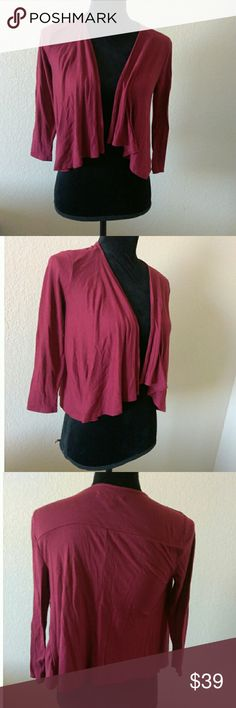 American Eagle Outfitters Maroon Cardigan Maroon Cover up cardigan by American Eagle Outfitters. Size XS. 65% Polyester, and 35% Viscose. Used, some piling but overall good condition. Approx measurements are 12 inches chest and 17.5 inches length. American Eagle Outfitters Sweaters