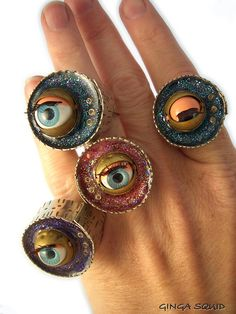 Vintage Dolls Eye Blinking Rings made with vintage blinking eyes from dolls and imbedded in resin. Some metals used to wrap the eyes and form the ring base -and mica powders created the glitter in this case