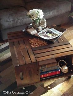 Great use of wooden crates and a nice way to store books and have a coffee table all at once.