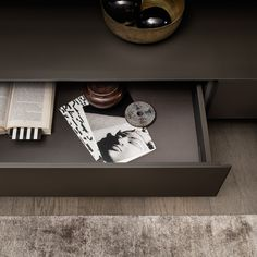 "a detail of the drawer that expresses a ""total look"" matching the moro aluminum structure with internal structure in brown leather melamine"