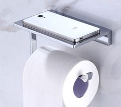 toilet roll holder with storage shelf for trendy hotel bathrooms