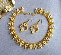 Cream and gold beaded necklace https://www.etsy.com/in-en/listing/536345359/cream-and-gold-beaded-necklace-beaded