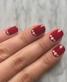 Three's a crowd—if you love a classic red manicure but prefer to step it up from time to time, a simple-yet-impactful design along the cuticles is a fresh and easy update.