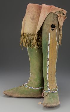 A PAIR OF COMANCHE BEADED HIDE BOOT MOCCASINS. c. 1880... (Total: | Lot #71125 | Heritage Auctions