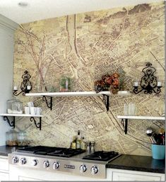 Susie Bohnsack, Pearhouse Designs. Turgot plan de Paris map above cooktop applied with wallpaper paste and several coasts of poly.  Vintage French sconces.