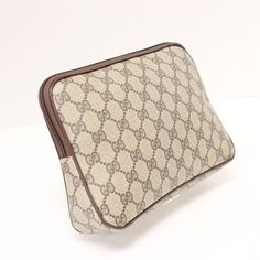 Gucci GG Monogram Canvas Brown Leather SSIMA Travel Cosmetic Makeup Bag. Get the lowest price on Gucci GG Monogram Canvas Brown Leather SSIMA Travel Cosmetic Makeup Bag and other fabulous designer clothing and accessories! Shop Tradesy now