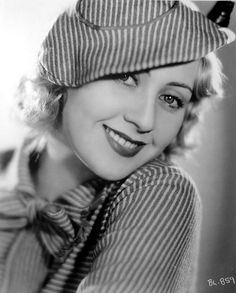 Joan Blondell wears a striped woolen outfit with hat to match in Sons o' Guns