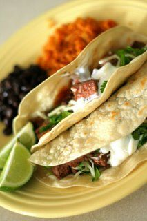 taqueria style tacos with flank steak, garlic, lime, chile powder, and paprika