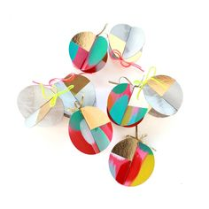 """Hand-painted and foil stamped chipboard ornaments. Two flat pieces fit together to make three dimensional ornaments.  Set of 8 ornaments with gold twine.  Illustrated and printed in our Iowa based studio.  Ornament size: 4 x 4"""" flat circles"""