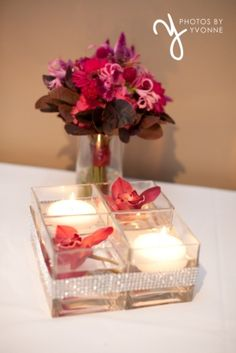 Super fun hot pink bouquet and centerpiece with cymbidium orchids and floating candles www.beautifulbloomsbyjen.com and photo by www.photosbyyvonne.net
